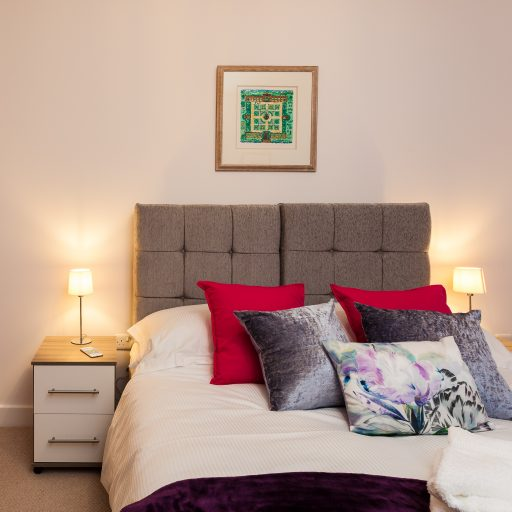 cropped-BQ-Bedroom-kingsize-bed-cushions.jpg